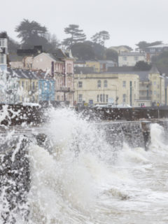 Large Waves Breaking Against Sea Wall At Dawlish In Devon