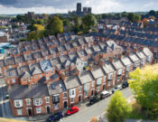 Durham, UK - October 14, 2015. Rows of terraced houses in the city of Durham with Durham Cathedral in the background.