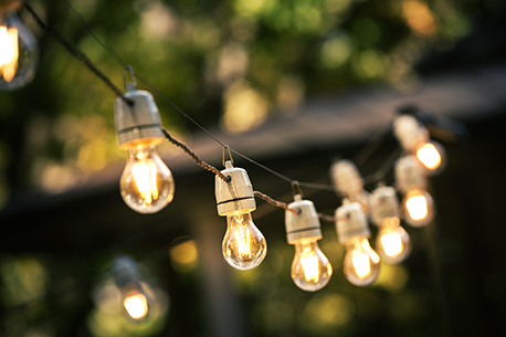 outdoor string lights hanging on a line in back garden