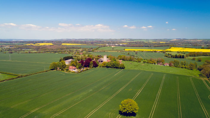 Aerial photo of Saint Martin's fortified church in Aldington, Kent, England